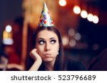 sad bored woman at a party... | Shutterstock . vector #523796689