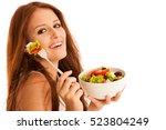 healthy eating    woman eats a... | Shutterstock . vector #523804249