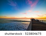 wooden pier in pacific beach at ... | Shutterstock . vector #523804675