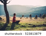 meditating in nature on a sunny ... | Shutterstock . vector #523813879