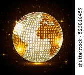 golden planet disco ball on a... | Shutterstock .eps vector #523816459