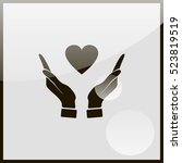 pictograph of heart in hand. | Shutterstock .eps vector #523819519