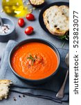 tomato soup in a black bowl on... | Shutterstock . vector #523823077