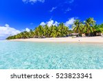 beach on a tropical island with ... | Shutterstock . vector #523823341