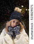 woman in love on snowy night    Shutterstock . vector #523829071