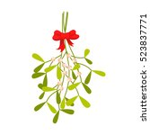 mistletoe branches tied with... | Shutterstock .eps vector #523837771