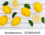 fresh ripe lemons on wooden... | Shutterstock . vector #523854181