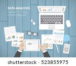 man analyzes documents.... | Shutterstock .eps vector #523855975