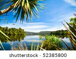 Sunny day at remote calm lake in New Zealand - stock photo