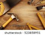 assorted work tools on wood | Shutterstock . vector #523858951