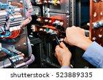 electrician near the low... | Shutterstock . vector #523889335