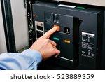 electrician near the low... | Shutterstock . vector #523889359