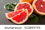 red grapefruit on a concrete... | Shutterstock . vector #523895755