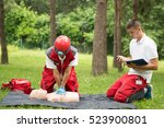 cpr practice of woman and man... | Shutterstock . vector #523900801