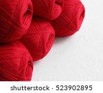 Red Yarn Balls On White...