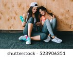 two girls talking fun in the... | Shutterstock . vector #523906351