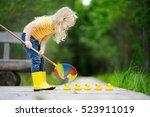 funny little girl helping five... | Shutterstock . vector #523911019
