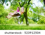 two cute little sisters having... | Shutterstock . vector #523912504