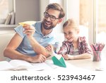 handsome father and his cute... | Shutterstock . vector #523943467