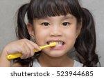 little asian cute girl brush... | Shutterstock . vector #523944685