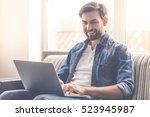 handsome businessman is smiling ... | Shutterstock . vector #523945987