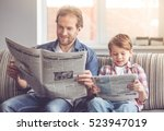 father and son are reading... | Shutterstock . vector #523947019