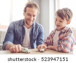 father and son are playing with ... | Shutterstock . vector #523947151