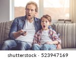 father and son are shocked... | Shutterstock . vector #523947169