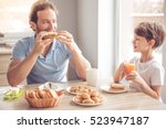 father and son are talking and... | Shutterstock . vector #523947187