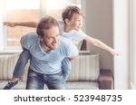 father and son are smiling... | Shutterstock . vector #523948735