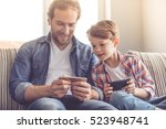 father and son are using... | Shutterstock . vector #523948741