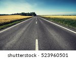 empty asphalt road and floral... | Shutterstock . vector #523960501