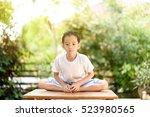 young thai boy practicing yoga... | Shutterstock . vector #523980565