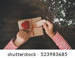 woman wrapping gift boxes with...   Shutterstock . vector #523983685