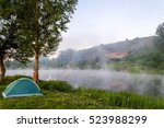 Green Camping Tent Near Tree...
