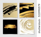 set of four black and gold ink... | Shutterstock .eps vector #523990579