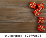 little red presents on wood... | Shutterstock . vector #523990675