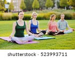 group of people doing yoga on... | Shutterstock . vector #523993711