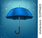 blue umbrella on snow... | Shutterstock .eps vector #523996825