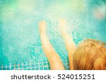 baby sitting near swimming pool. | Shutterstock . vector #524015251