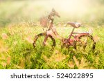 little pink bicycle on grass...   Shutterstock . vector #524022895