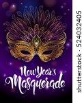 golden carnival mask with... | Shutterstock .eps vector #524032405