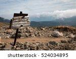 weather beaten wooden signpost...   Shutterstock . vector #524034895