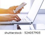 woman's hands using laptop and... | Shutterstock . vector #524057905