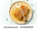 sweet honeycomb and dipper on... | Shutterstock . vector #524060005
