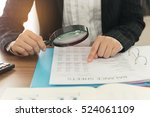 business women using magnifying ... | Shutterstock . vector #524061109