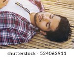 young man sleep on bamboo bed. | Shutterstock . vector #524063911