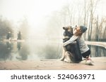 Stock photo image of young girl with her dog alaskan malamute outdoor 524063971