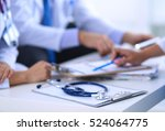 happy medical team discussing... | Shutterstock . vector #524064775