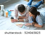 couple choosing paint colour... | Shutterstock . vector #524065825
